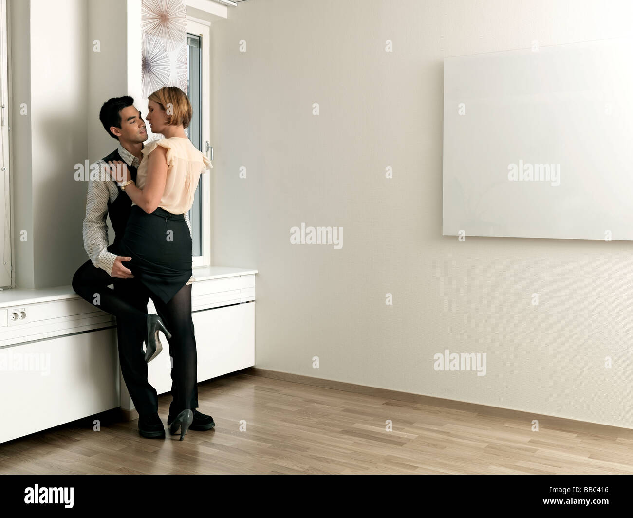 Couple caressing in office - Stock Image