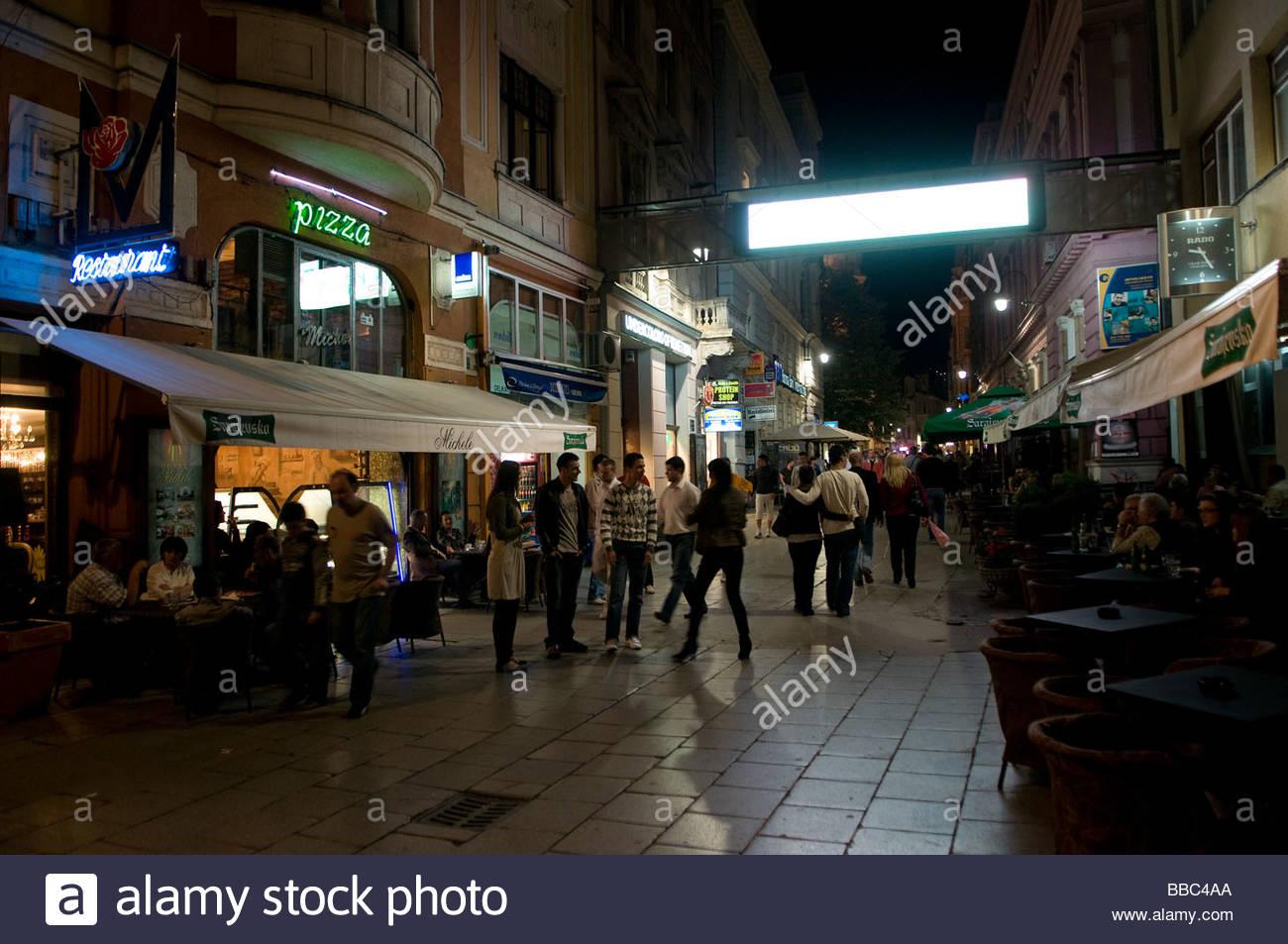 Pedestrians walking along Ferhadija street in the old town of Sarajevo capital of Bosnia Herzegovina - Stock Image