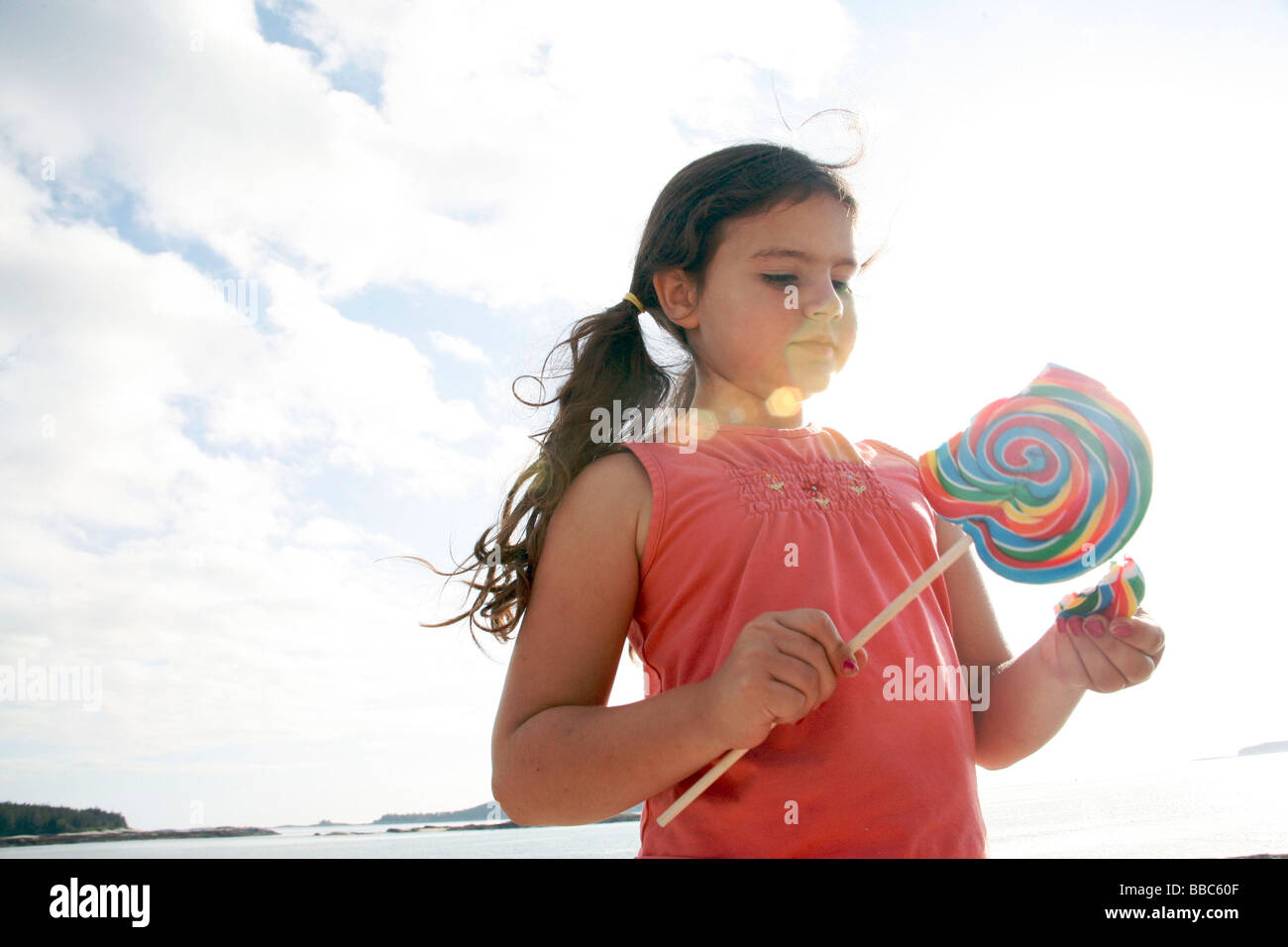 Little girl with huge lolly pop - Stock Image