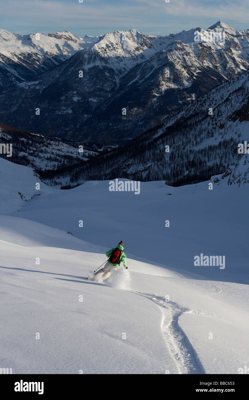 Skier, skiing off piste. - Stock Image