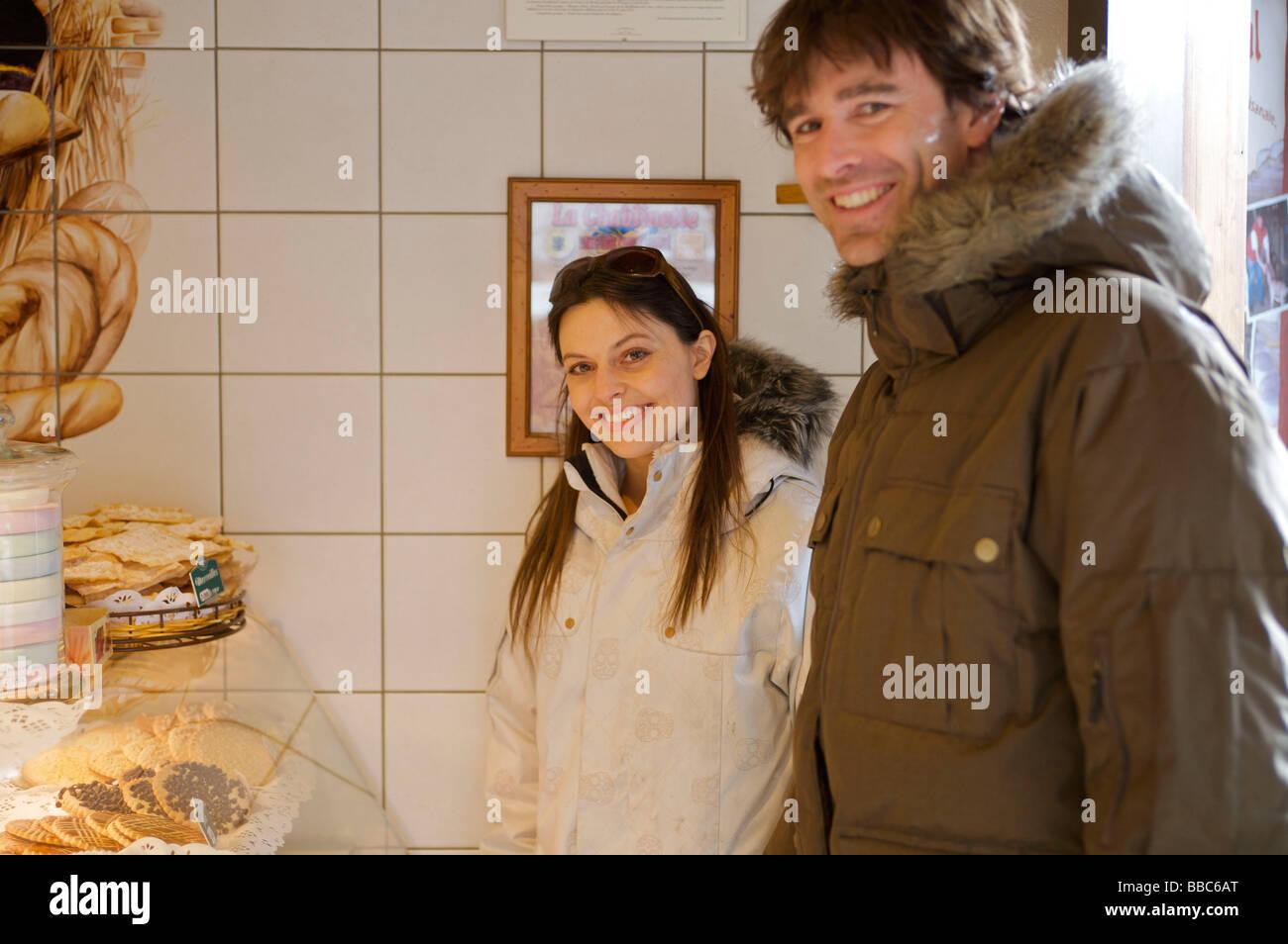 Couple in casual ski wear. - Stock Image