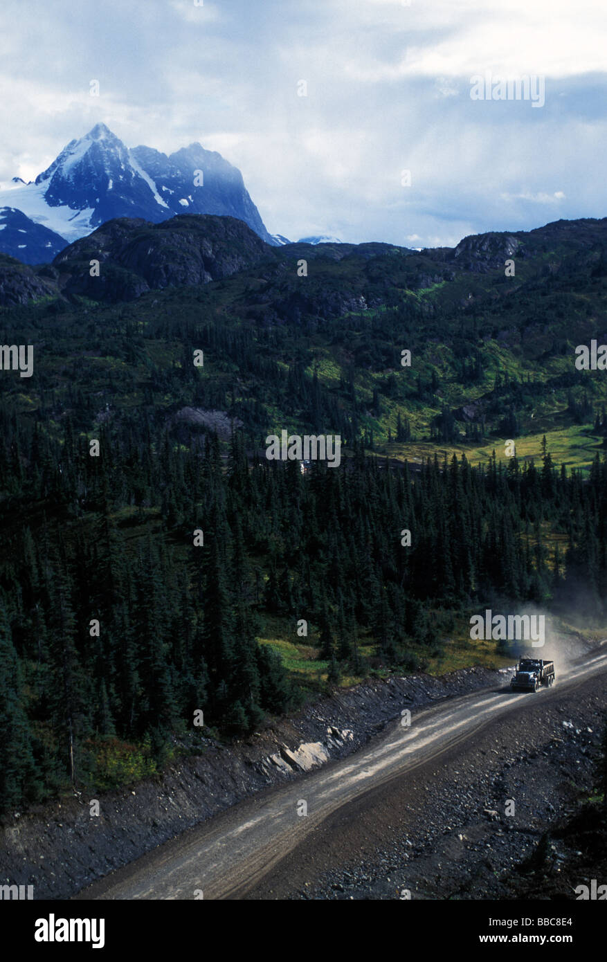 Dump truck working on new mine road, BC, Canada. - Stock Image