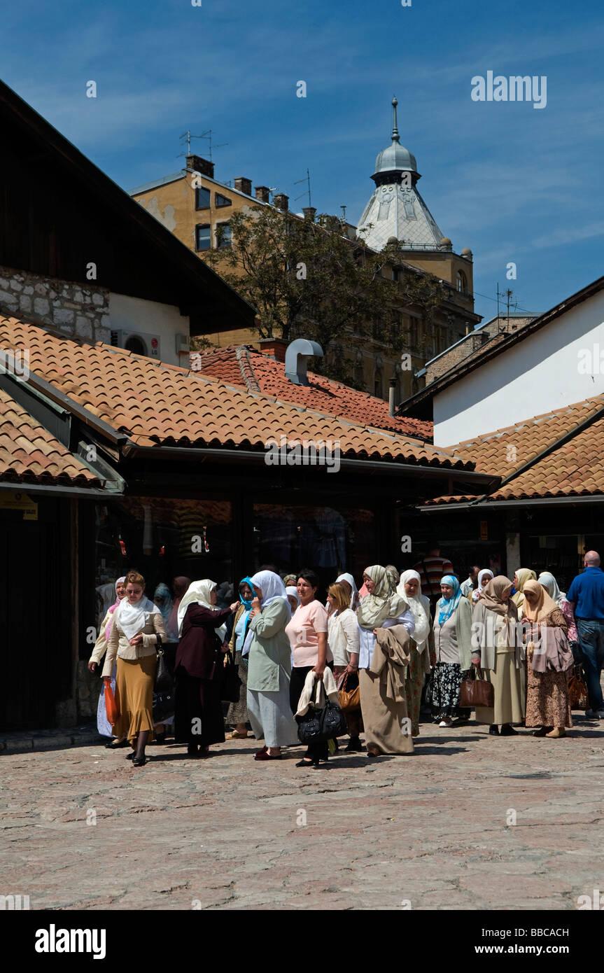 Muslim women in traditional clothing walking in Bascarsija district old city of Sarajevo in Bosnia Herzegovina - Stock Image