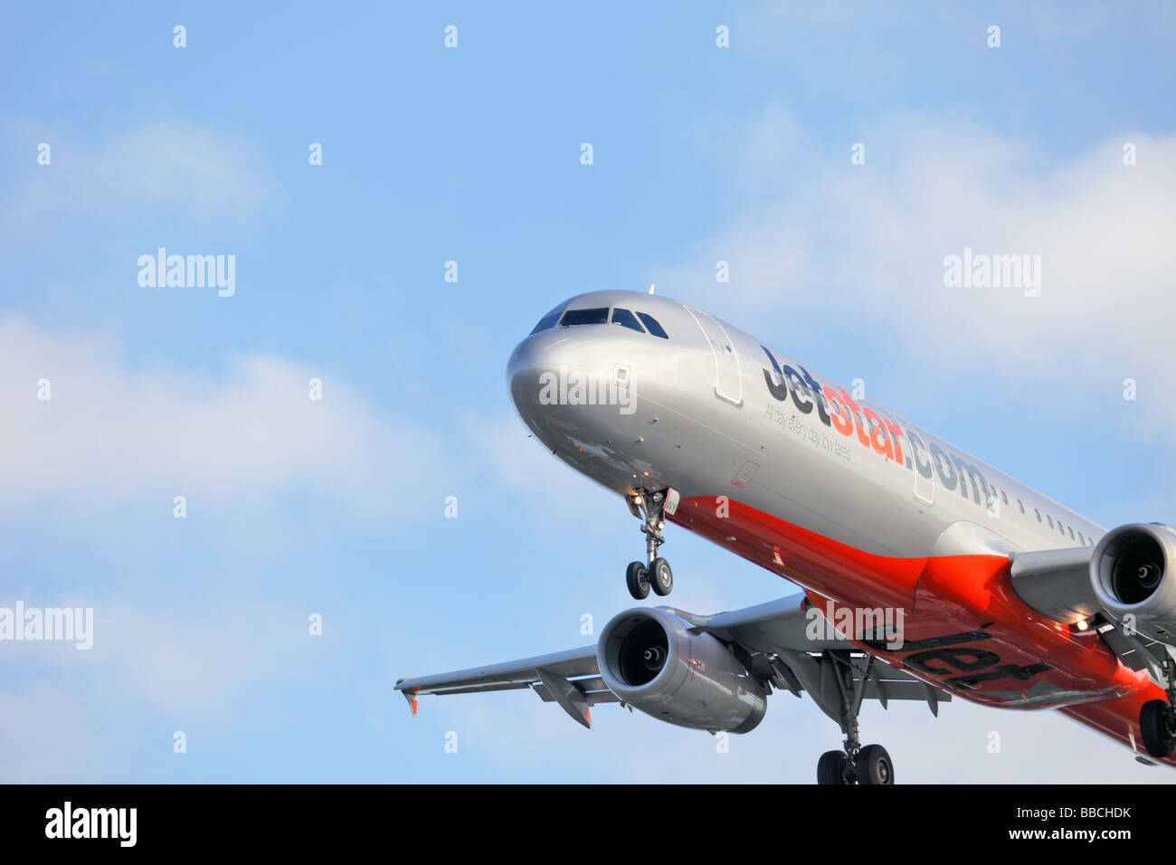 Passenger commercial jet Airbus 320 coming into land - Stock Image