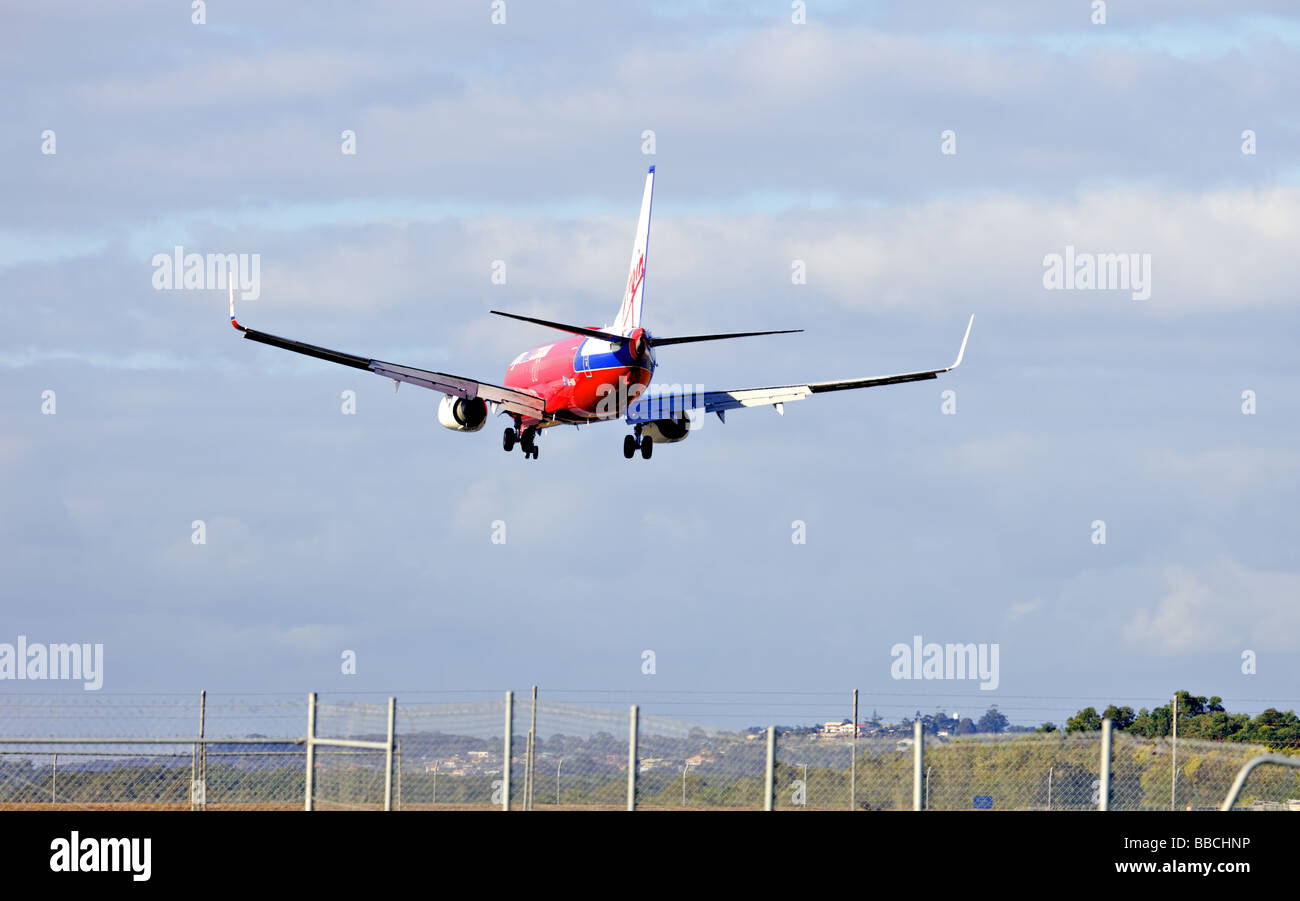 Passenger commercial jet Boeing 737 coming into land - Stock Image