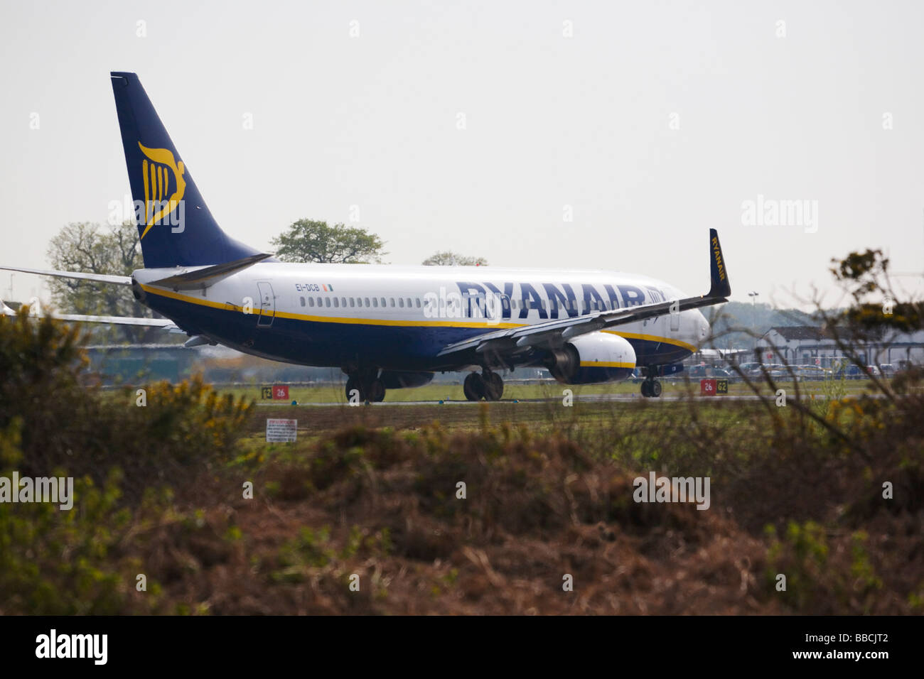 Ryanair aircraft, a Boeing 737-8AS, lining up on the runway, ready for take off at Bournemouth Airport. Dorset. - Stock Image