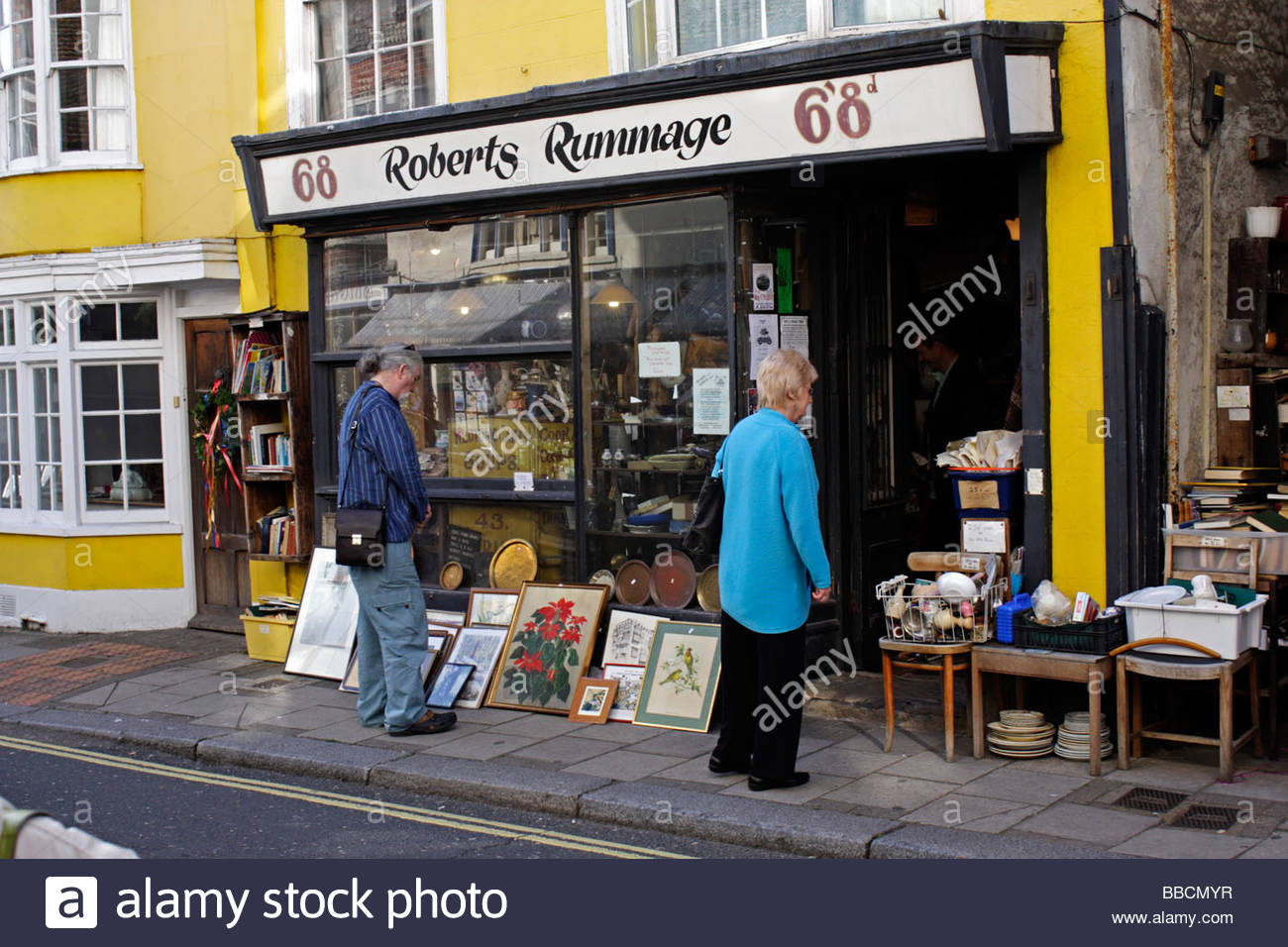 Rummage shop in the High Street Hastings selling a mixture of antiques and junk; East Sussex - Stock Image