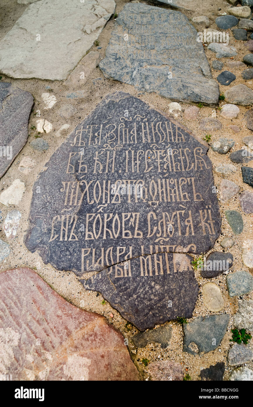 A monk's gravestone with epitaph in old church Slavonic at Kirillo-Belozersky monastery - Stock Image