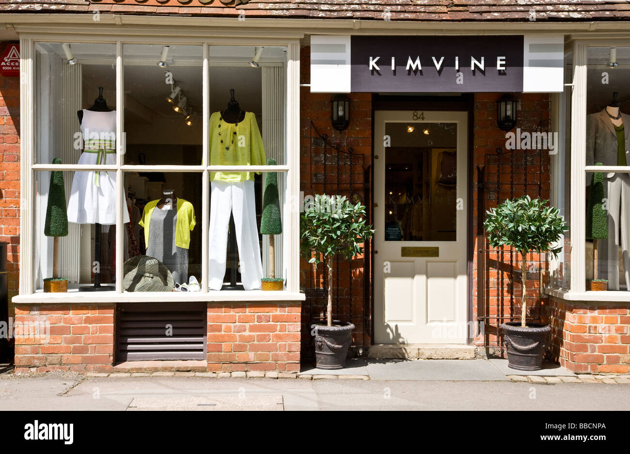 Window display of an upmarket ladies fashion clothing shop or boutique - Stock Image