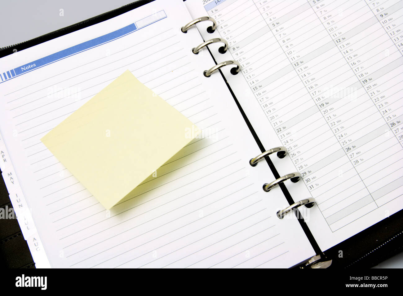 Post It Note on Pocket Organizer - Stock Image