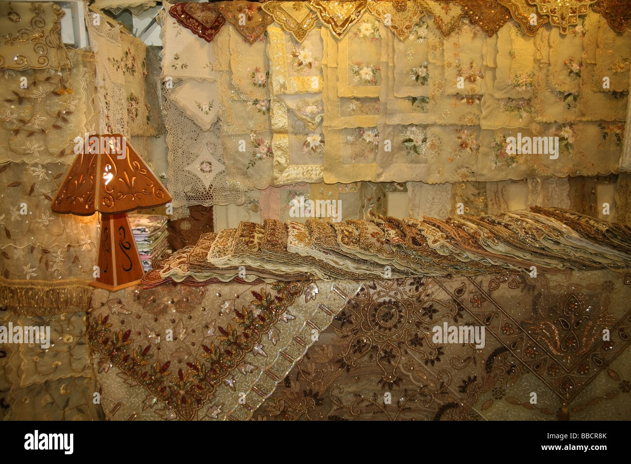 Lace table cloths cushion covers Souq Aleppo Syria - Stock Image