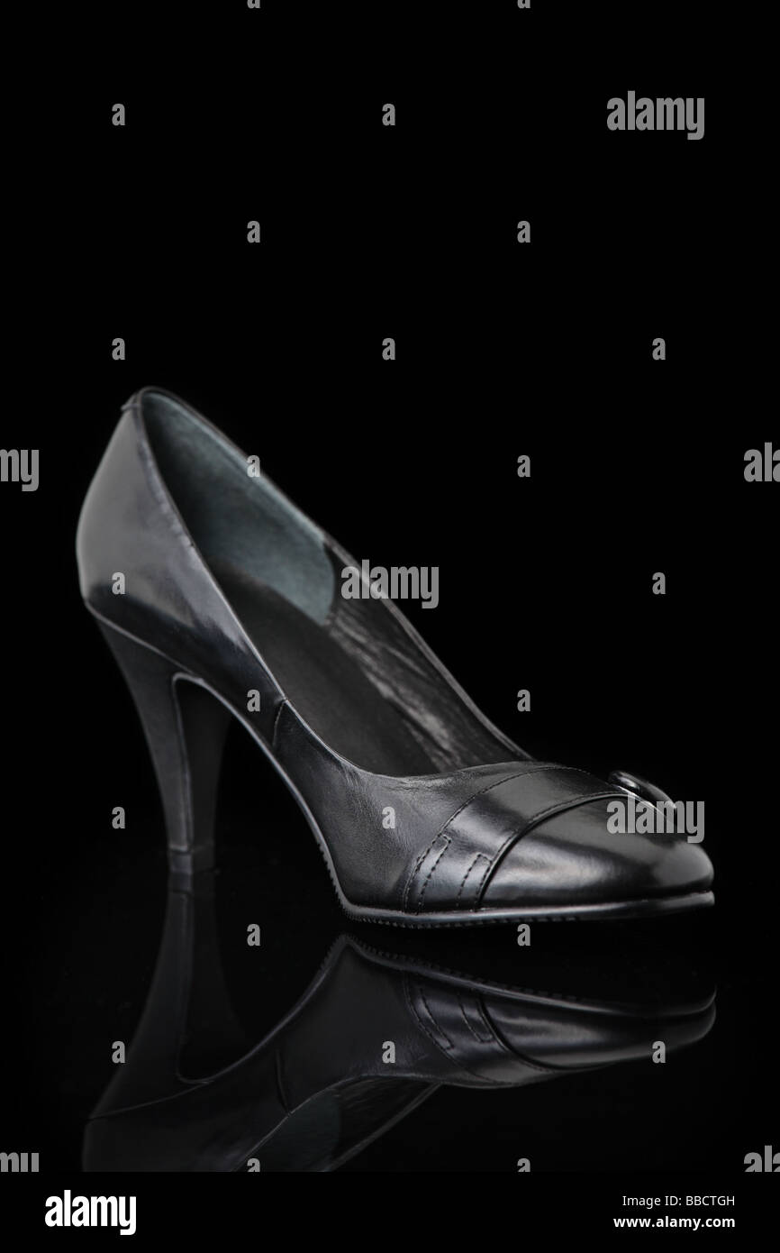 Luxurious designer shoes isolated against black background - Stock Image