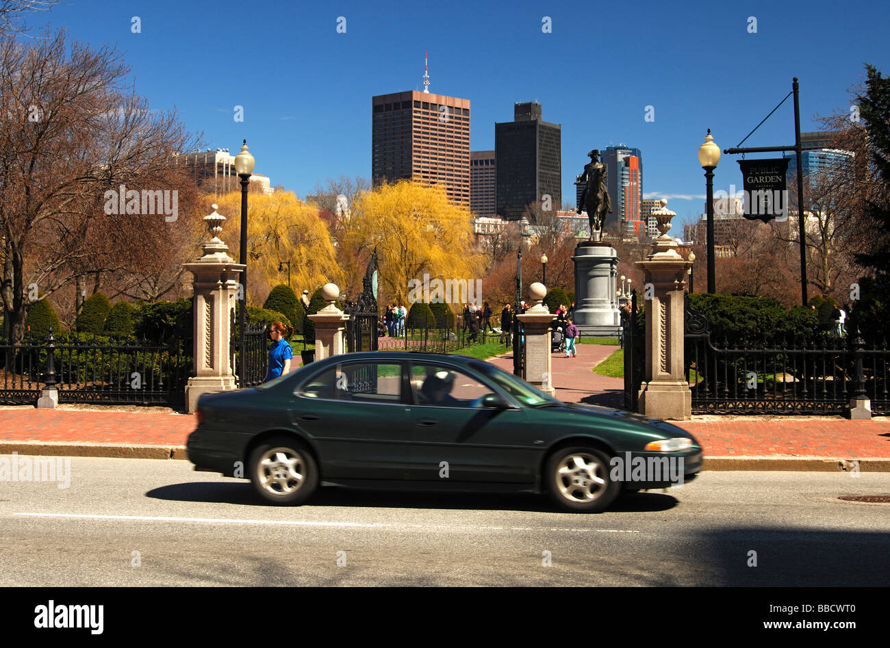 At the the entrance to the Public Garden of Bosten, skyline of the financial center in the back, Boston, Massachusetts, - Stock Image