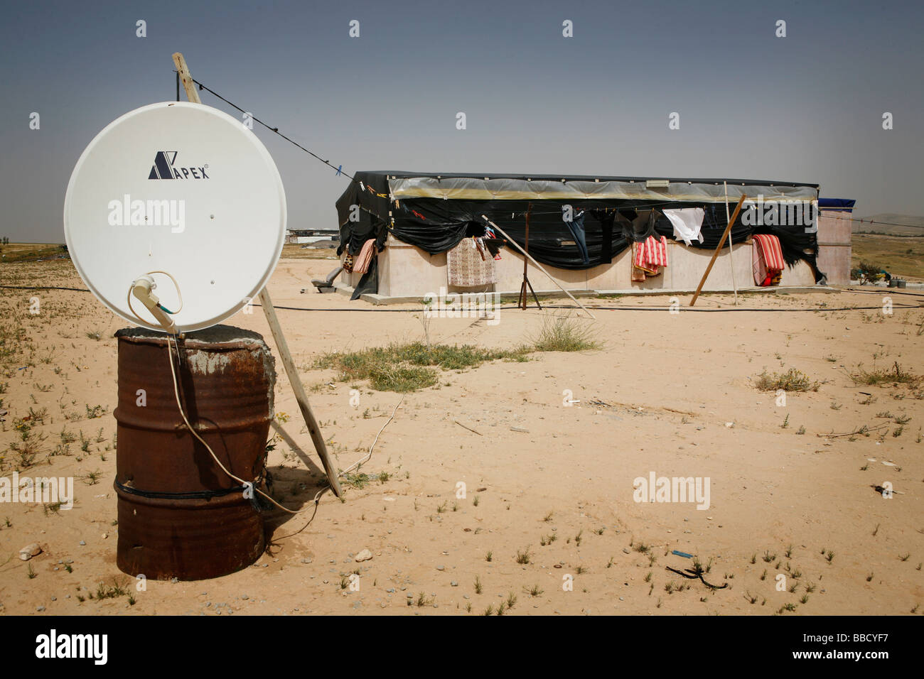 The house of a Bedouin family in the village of El Araqeeb. Houses are built cheaply for fear of demolition by Israel's - Stock Image