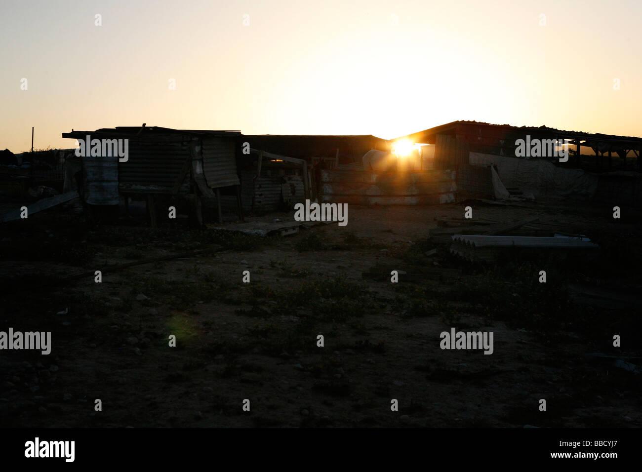 Chicken sheds at sundown. El Araqeeb, Israel - Stock Image