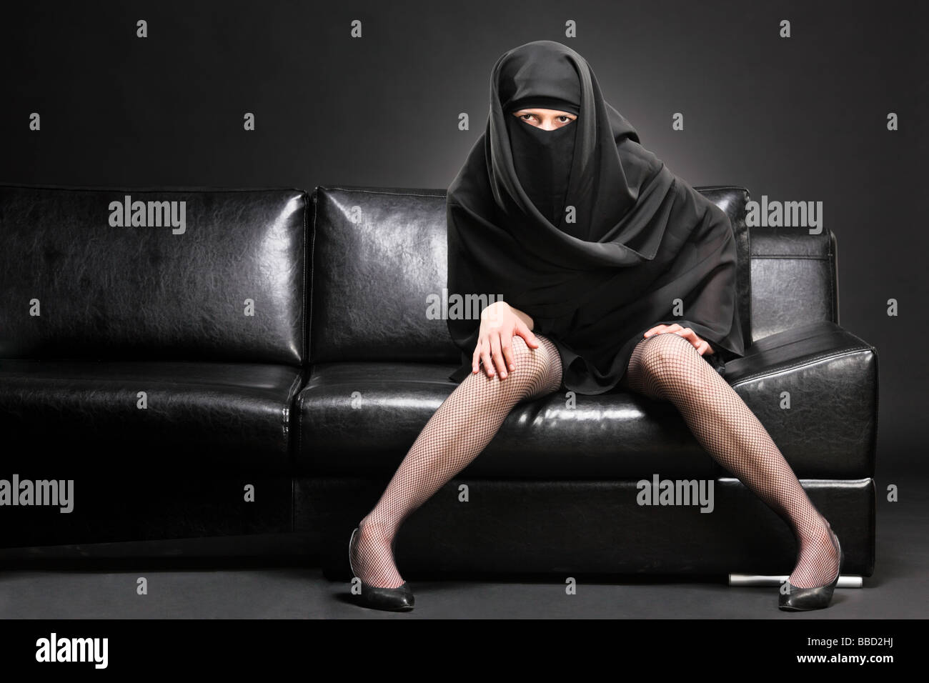 Arabic woman on a sofa Stock Photo