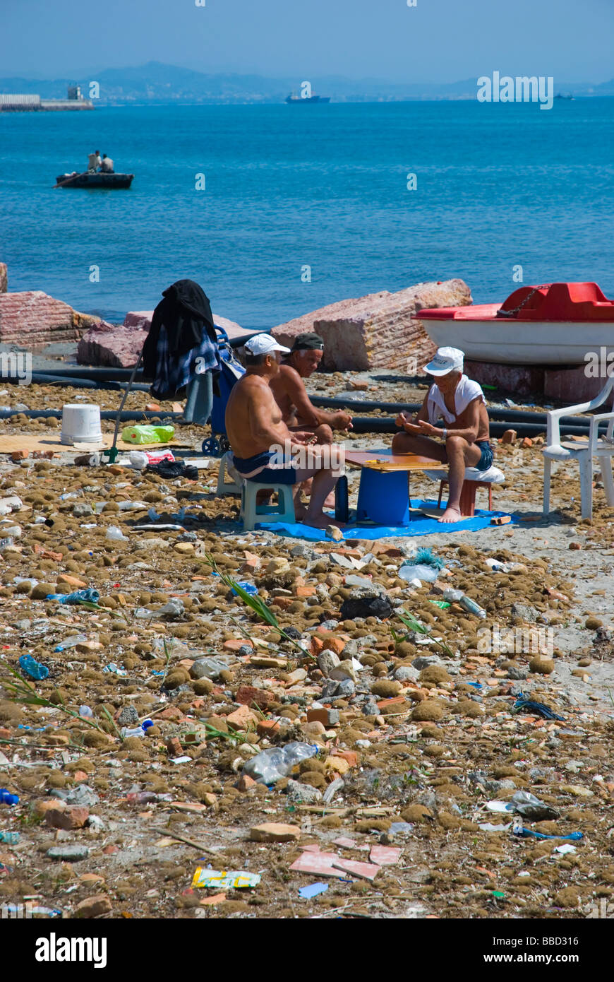 People playing a boardgame on a dirty beach in Durres Albania Europe Stock Photo
