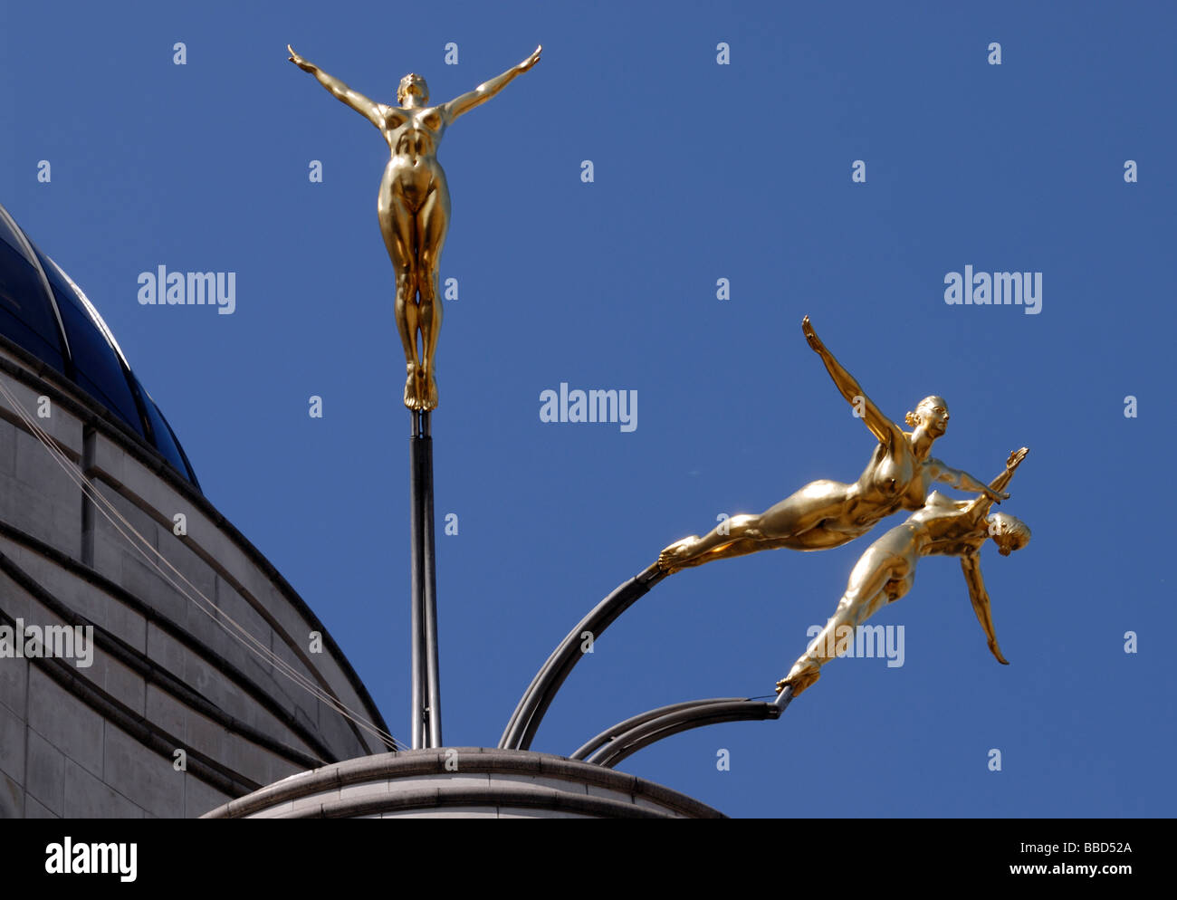Gold leaf covered aluminium statues by Rudy Weller of the three graces diving from the roof of 1 Jermyn Street,Stock Photo