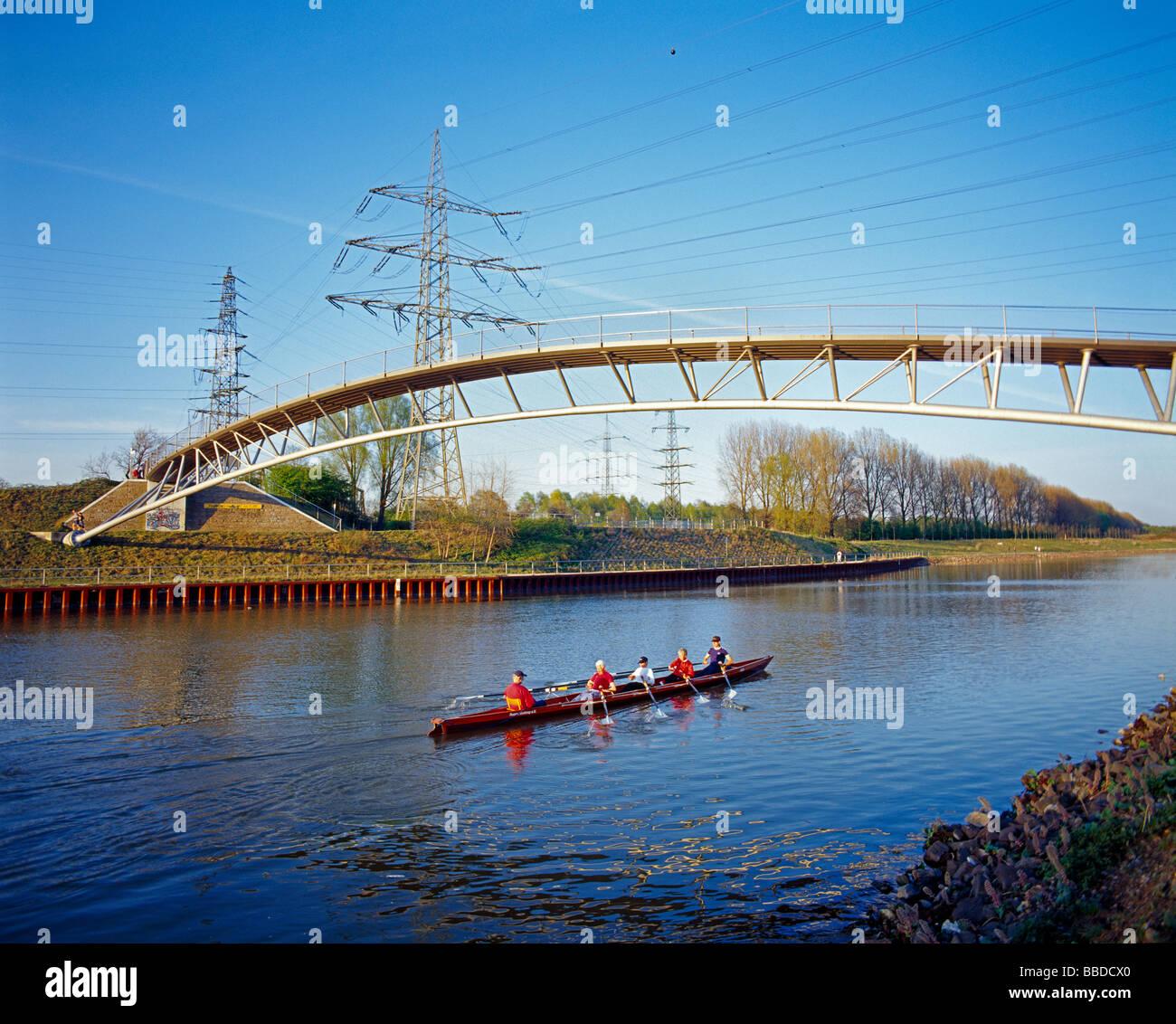 oarsmen in a foursome are rowing under a pedestrian bridge over the Rhein Herne Canal Kulturhauptstadt Europa 2010 Stock Photo