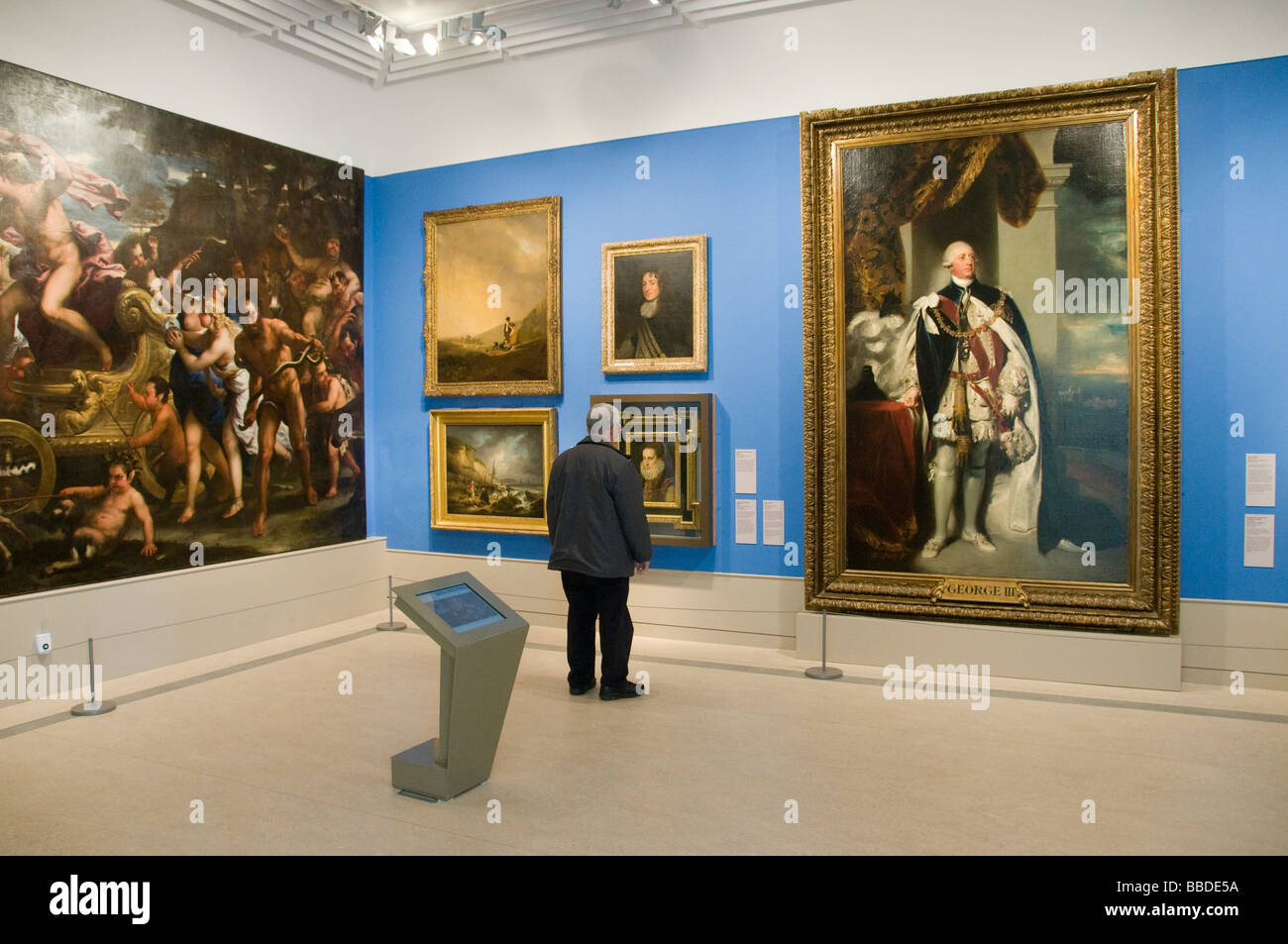 A man looking at paintings including Bacchus and Ariadne at Herbert Art Gallery and Museum in Britain Stock Photo