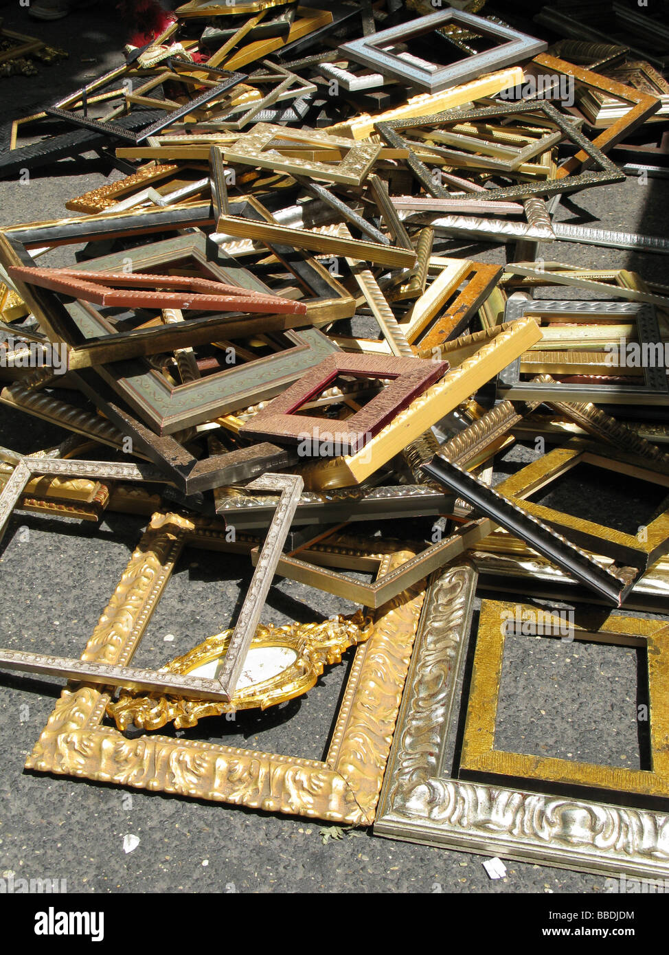 lots of old picture frames for sale in street market Stock Photo ...