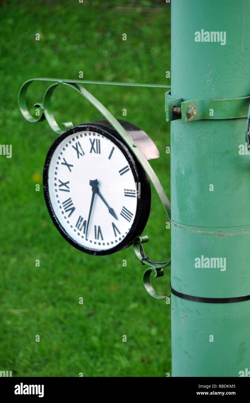 Outdoor Antique Pole Clock - Stock Image