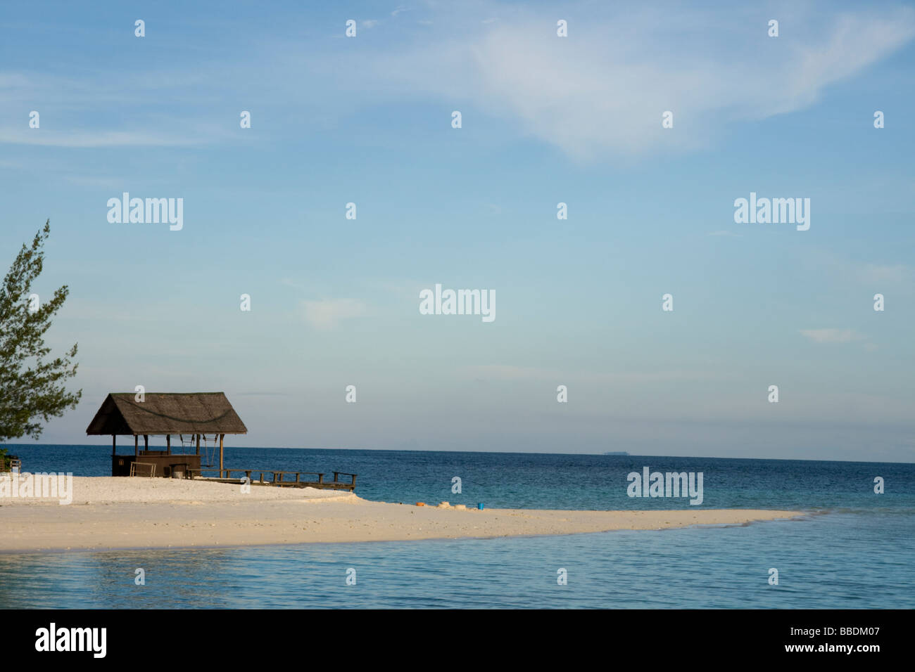 Deserted beach and hut, tropical island resort of Lankayan, Malaysian Borneo - Stock Image
