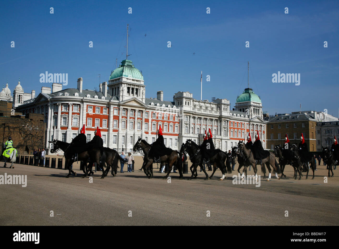 Household Cavalry - Blues and Royals - leave Horse Guards Parade after completing the Changing the Guard, Whitehall, Stock Photo