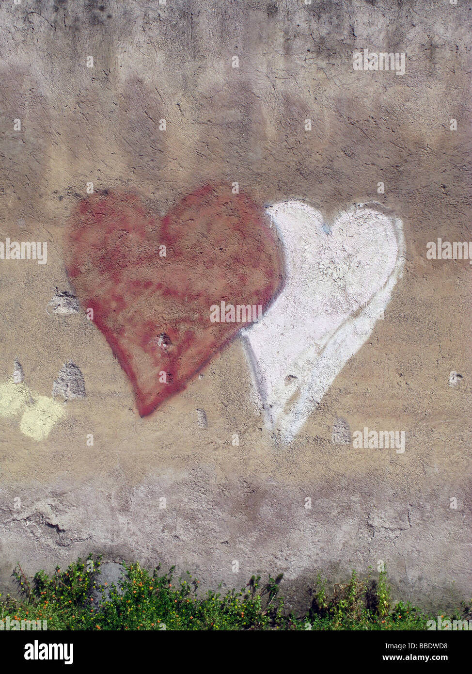 Two Love Hearts Graffiti Drawing On Wall In City Town Stock Photo
