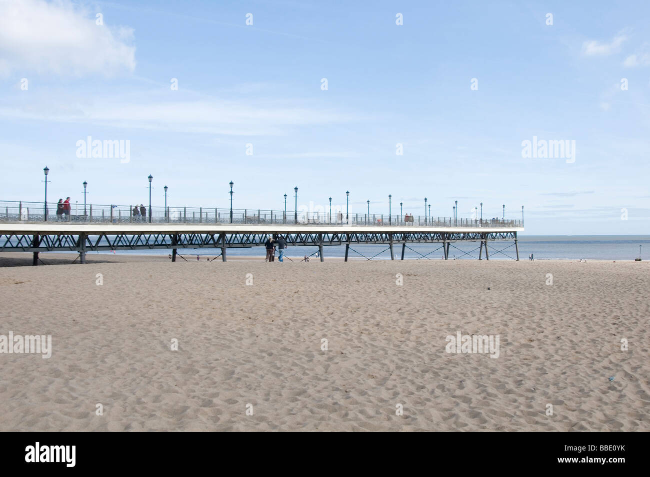 skegness linconshire coast seaside resort uk england english poer beach beaches piers sand north sea tide gone out - Stock Image