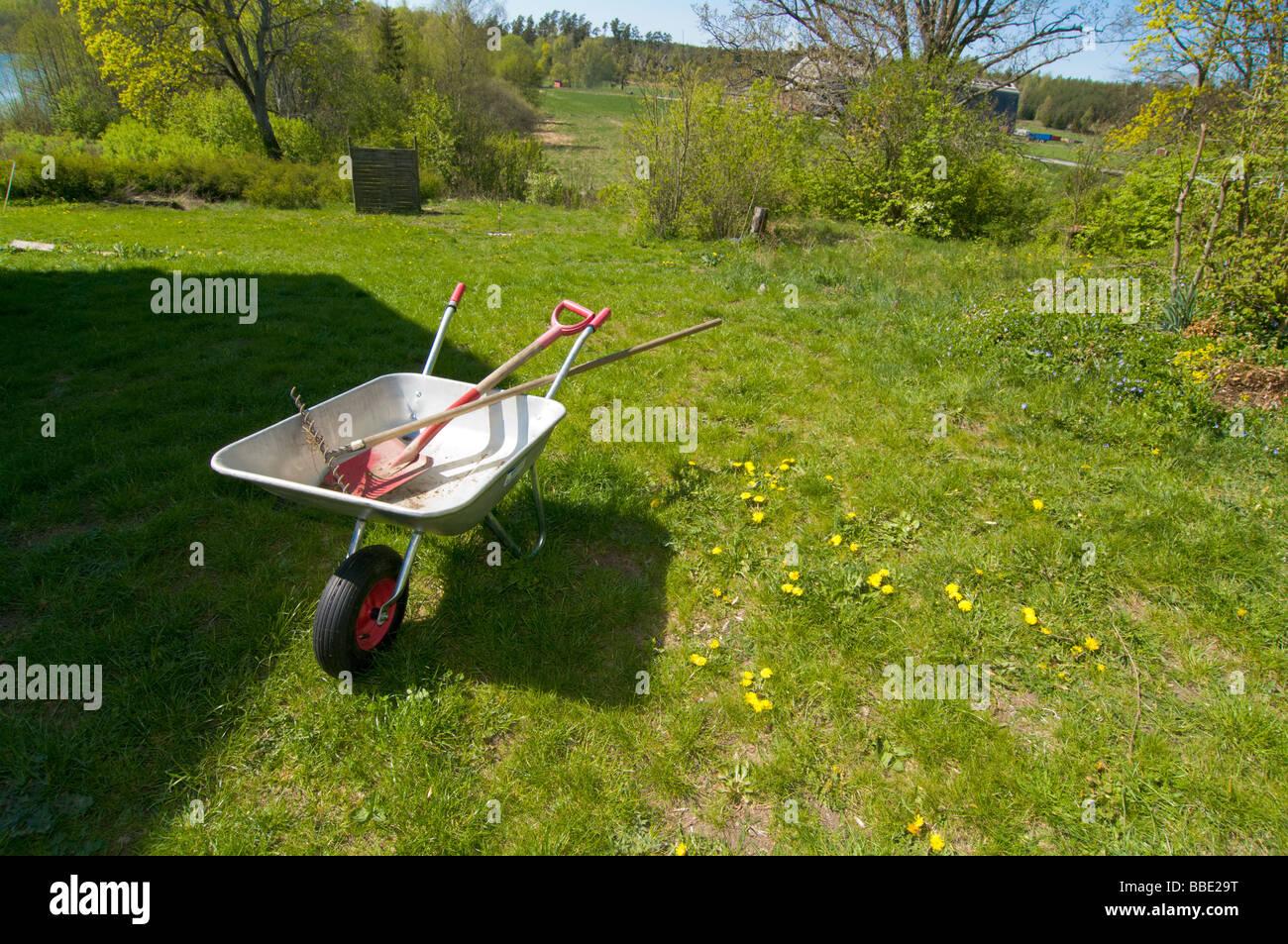 wheelbarrow in the garden - Stock Image