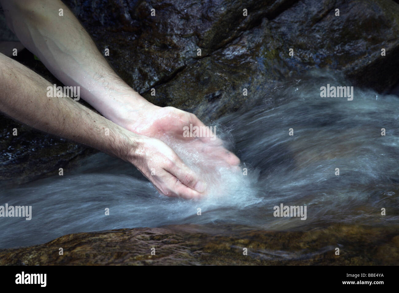 Washing hands in a stream, Todtnau, Black Forest, Germany, Europe - Stock Image