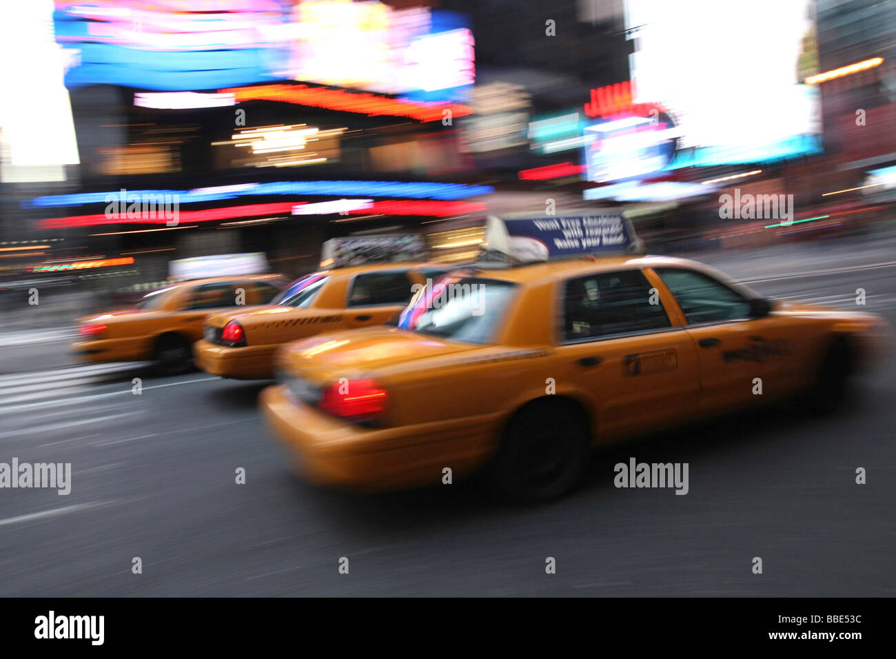 Taxi cabs in Times Square, Manhattan, New York City, USA - Stock Image