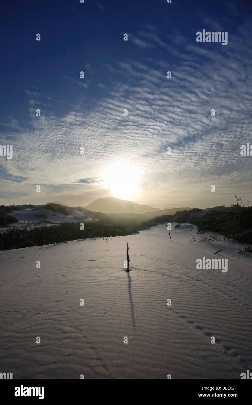 sundial in the sand - Stock Image