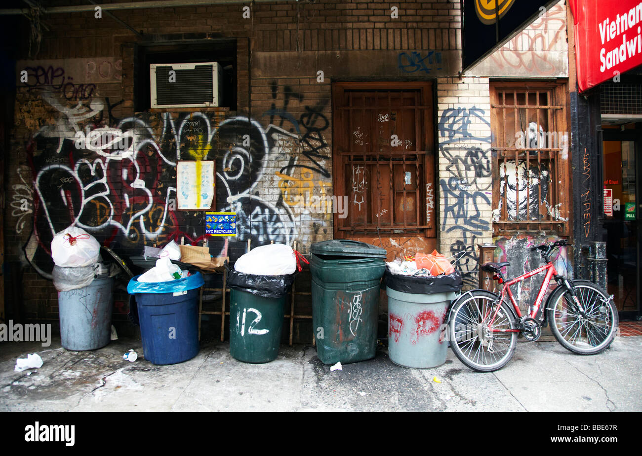 trash cans on street corner, New York - Stock Image
