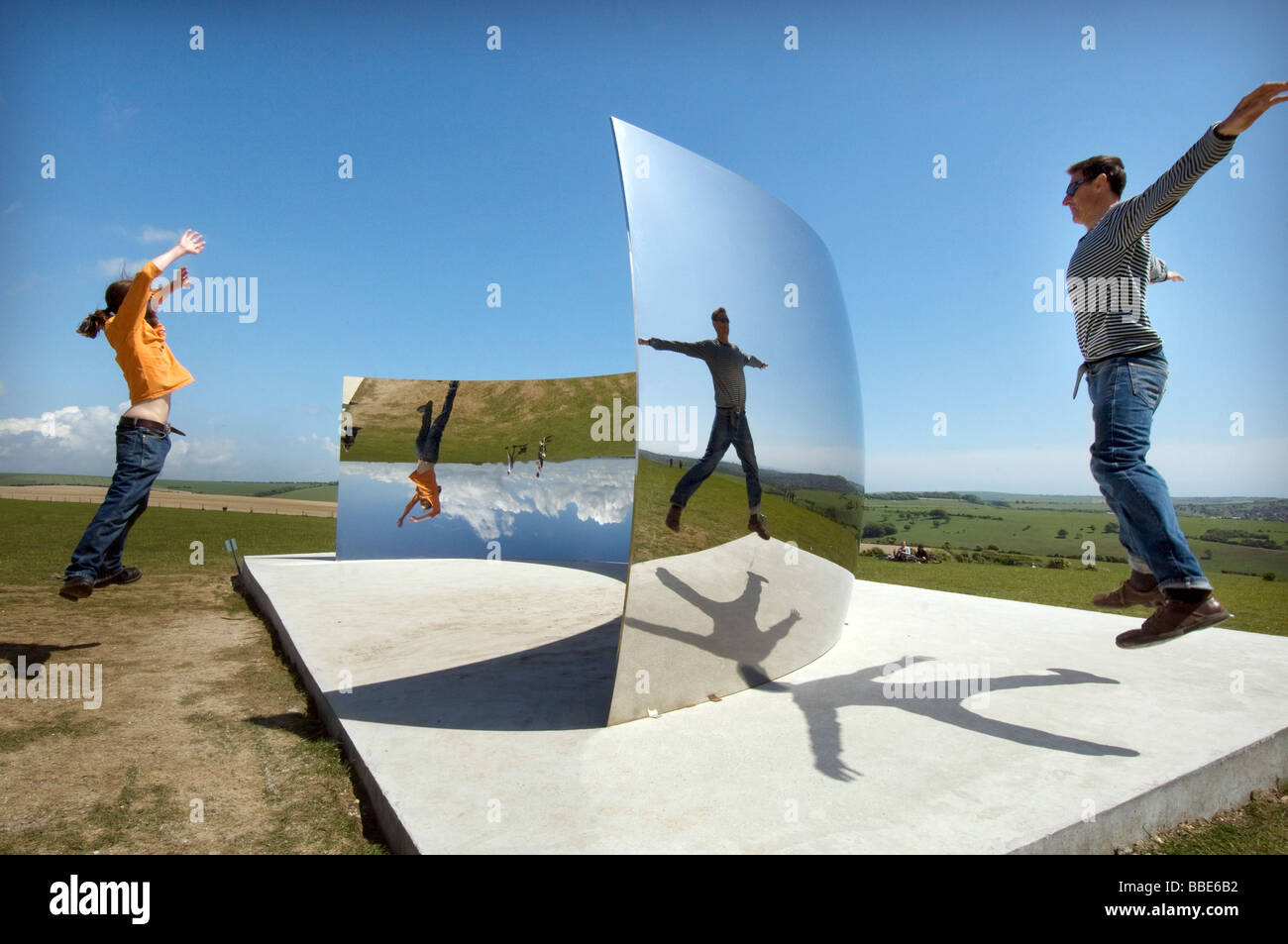 Enjoying reflections in the C Curve by sculptor Anish Kapoor on the South Downs near Clayton for the 2009 Brighton - Stock Image