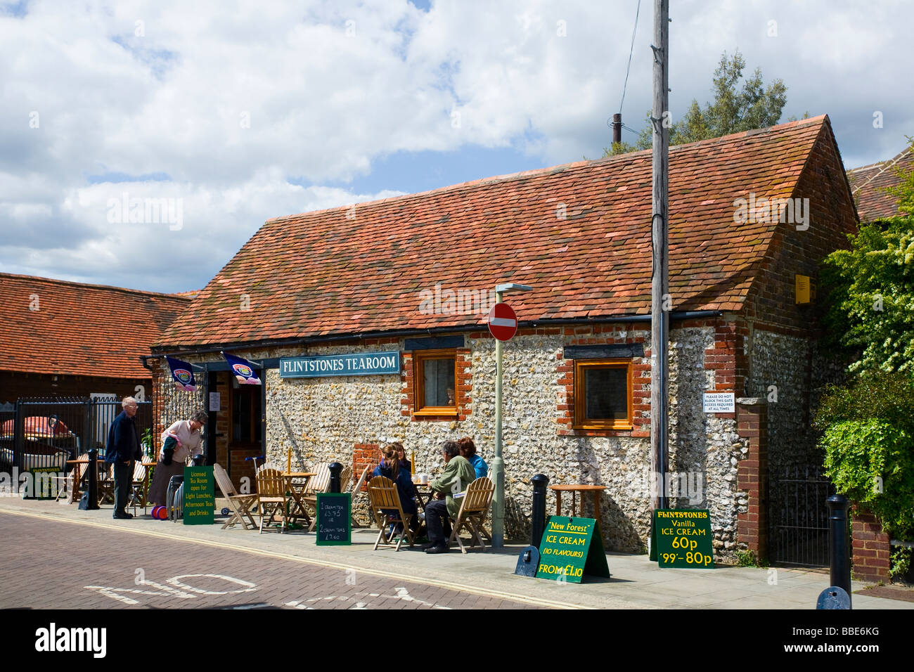 People sitting outside Flinstones Tearooms, Emsworth, Hampshire, UK Stock Photo