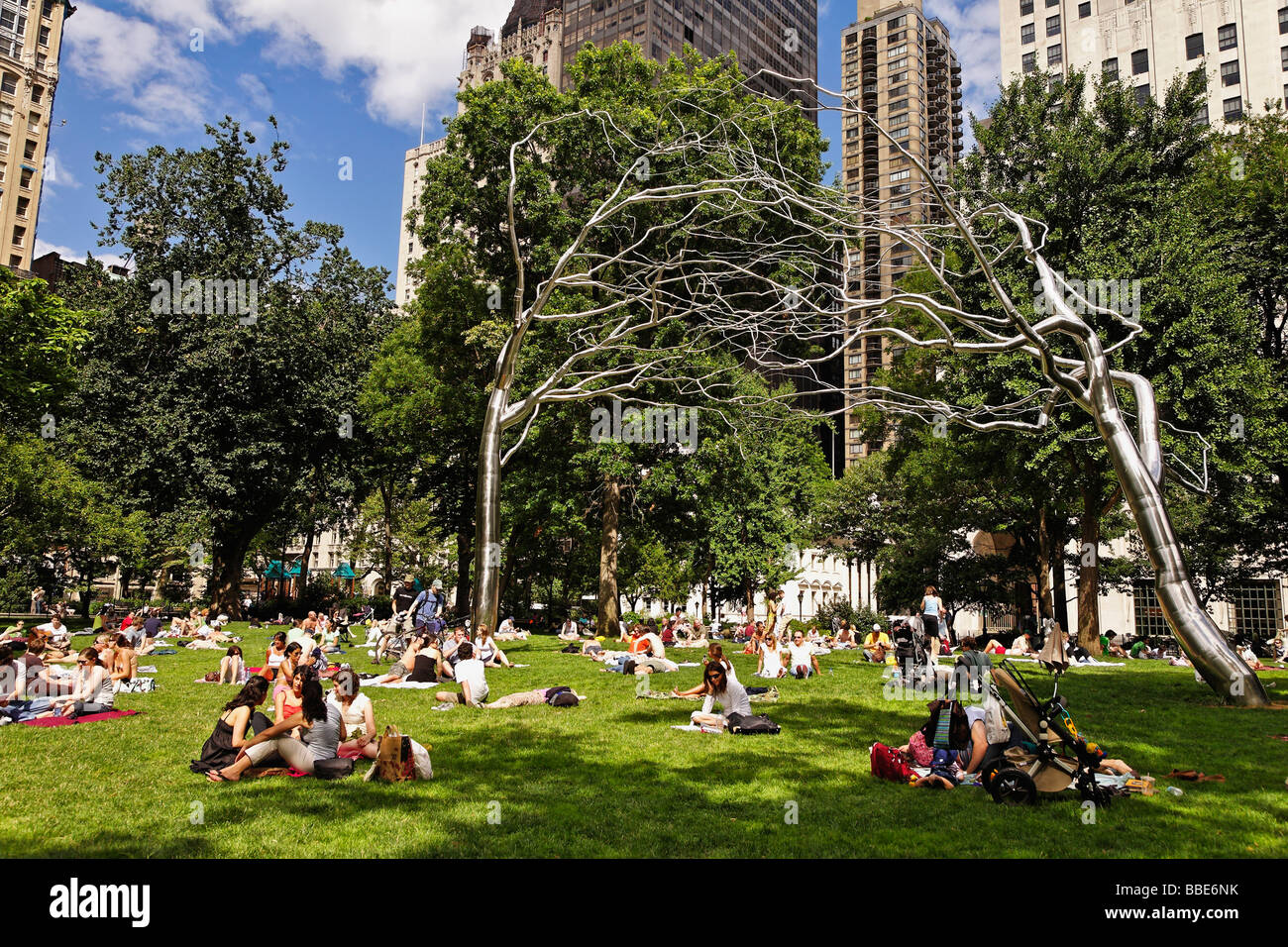 Locals enjoy a sunny weekend in Madison Square Park Clock tower of the Metropolitan Life Insurance Company - Stock Image