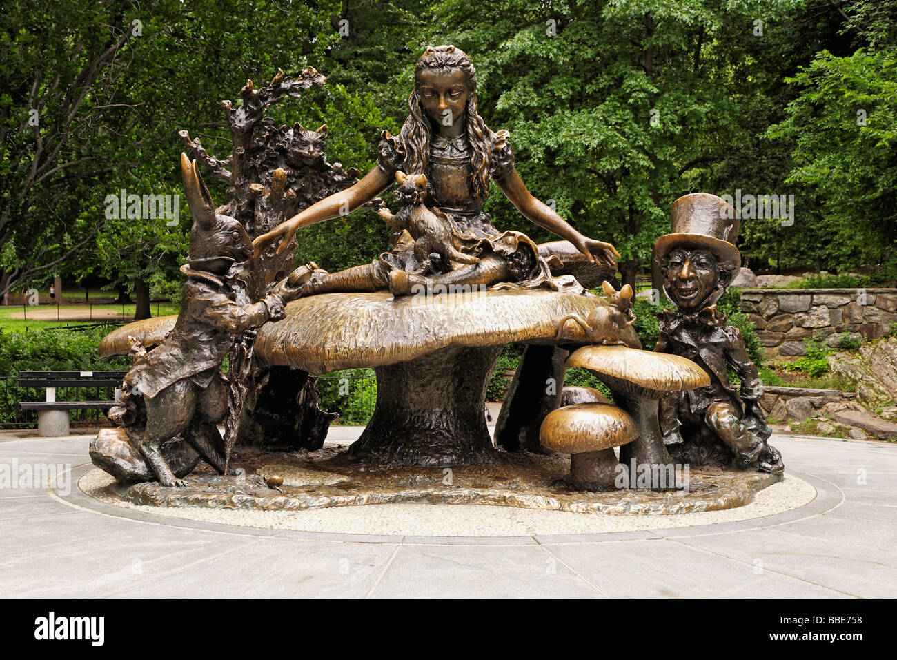 Alice in Wonderland is a bronze statue showing her along with her ...
