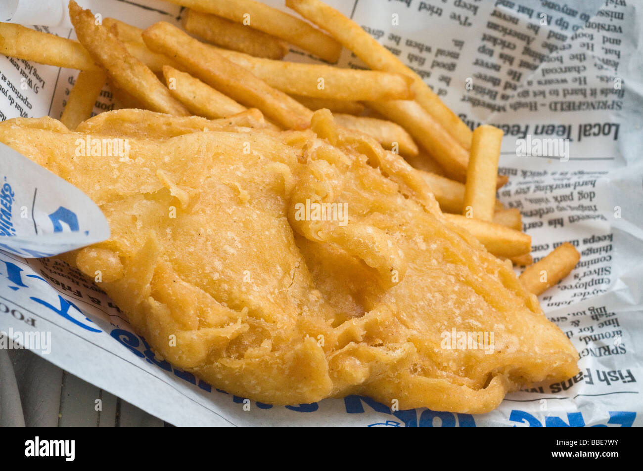 Fried fish and chips on newspaper Stock Photo