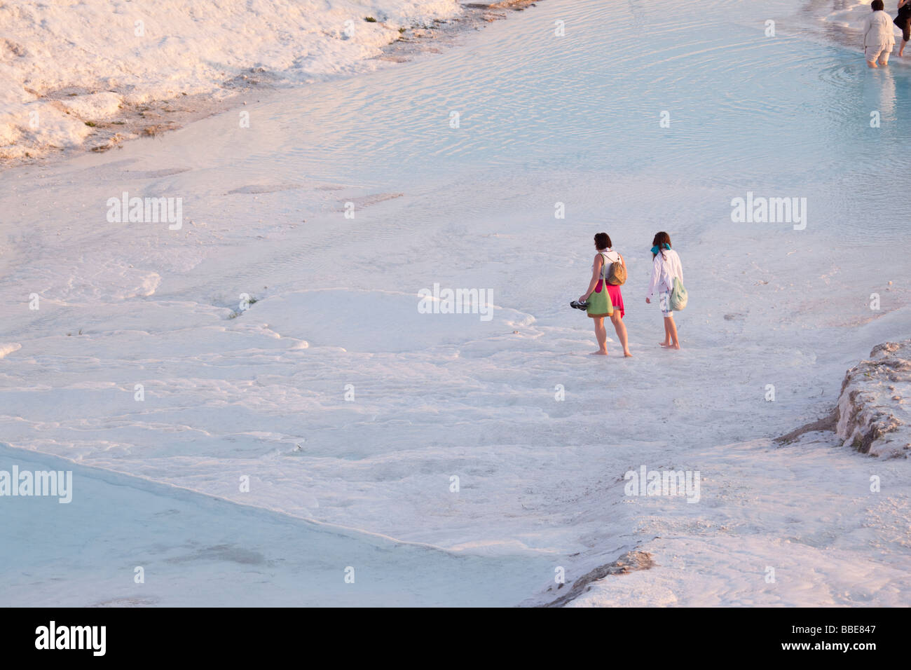 Tourists wading in the pools at Pamukkale in Turkey - Stock Image