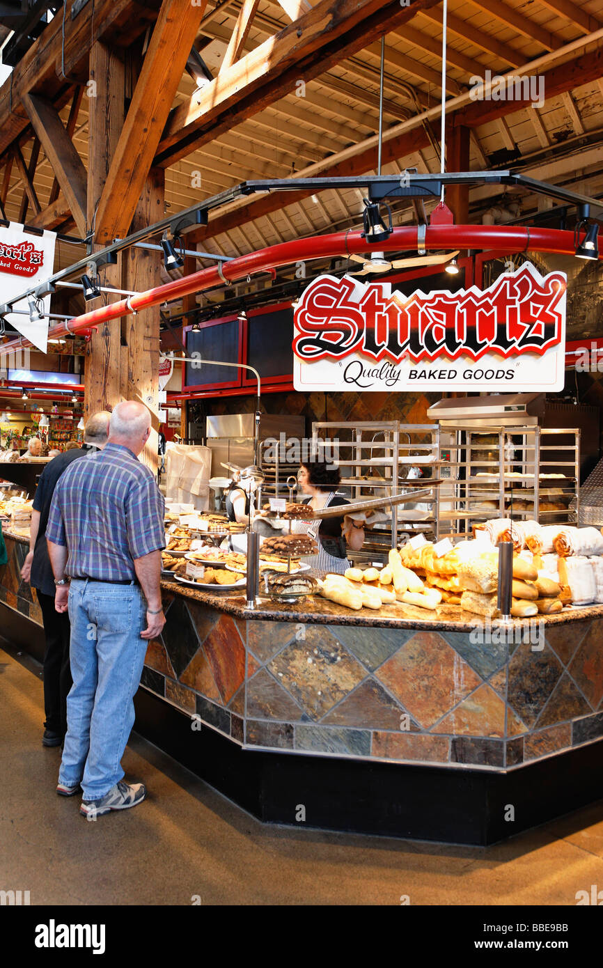 The Public market on Granville Island is best known for its vast selection of specialty foods and popular with both - Stock Image