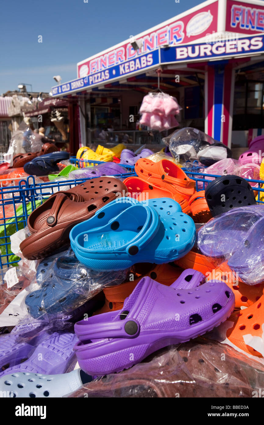 UK England Norfolk Hemsby Beach Road market stall selling inexpensive plastic beach shoes - Stock Image