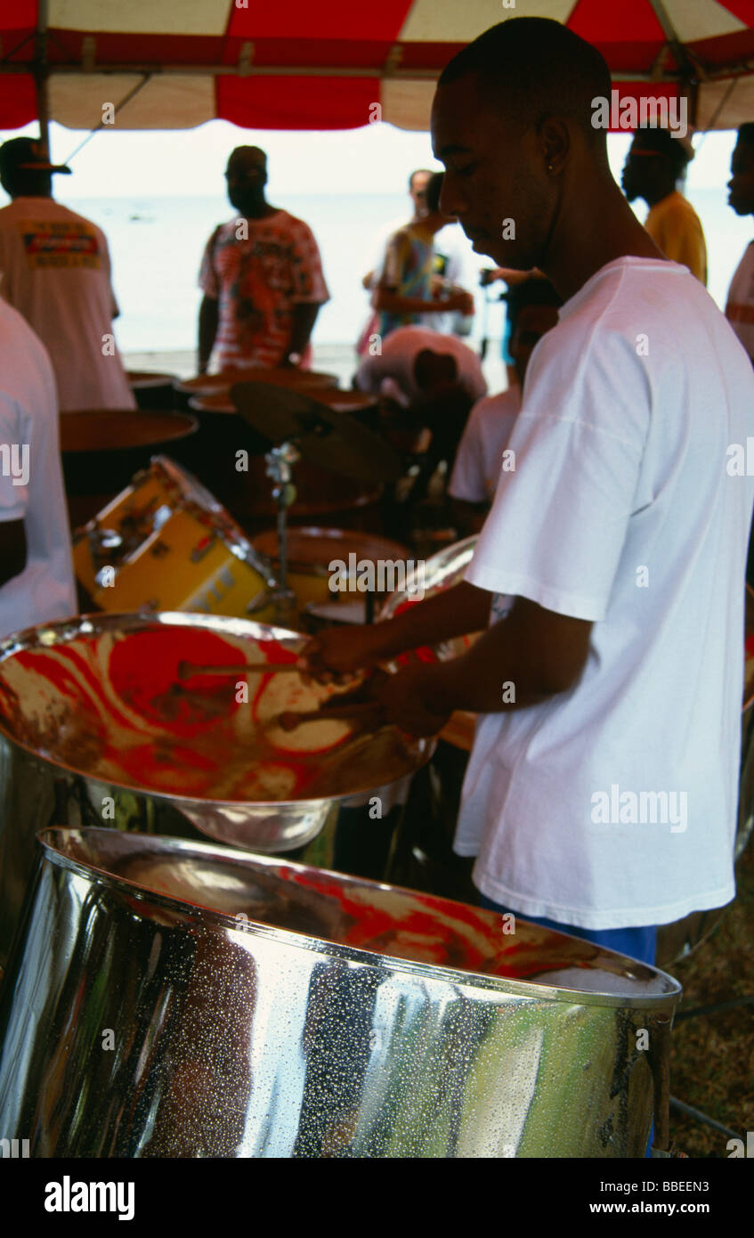 WEST INDIES Caribbean Tobago Katzenjammer steel band drummers playing pans under a red and white canopy - Stock Image