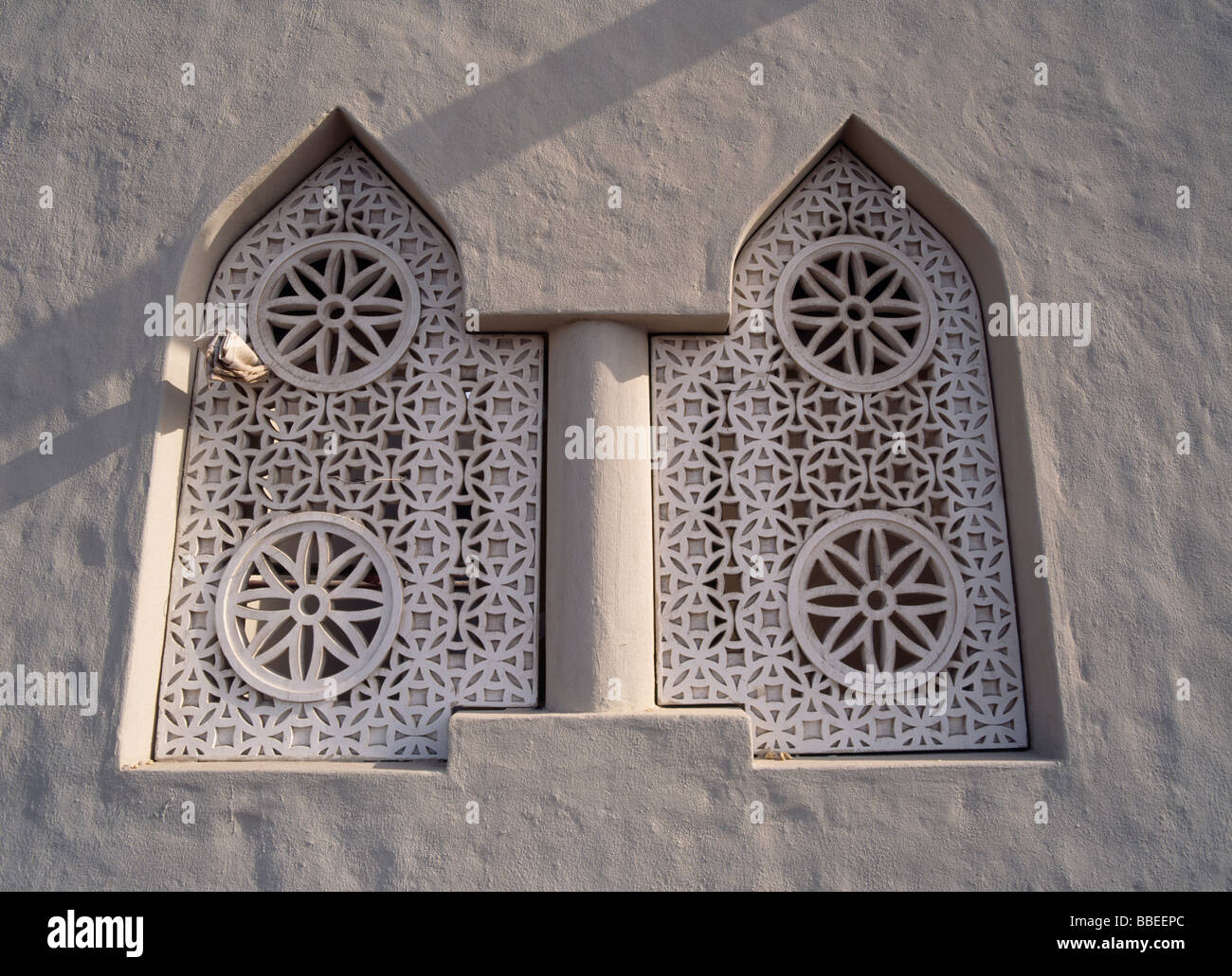 Qatar doha ornate carved fretwork detail of two windows on