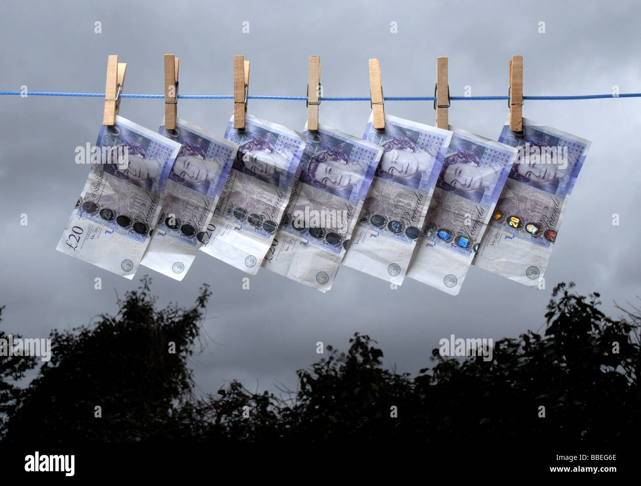 £20 notes on a washing line - Stock Image