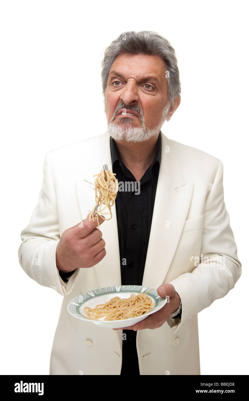 italian mobster eating a bowl of pasta - Stock Image
