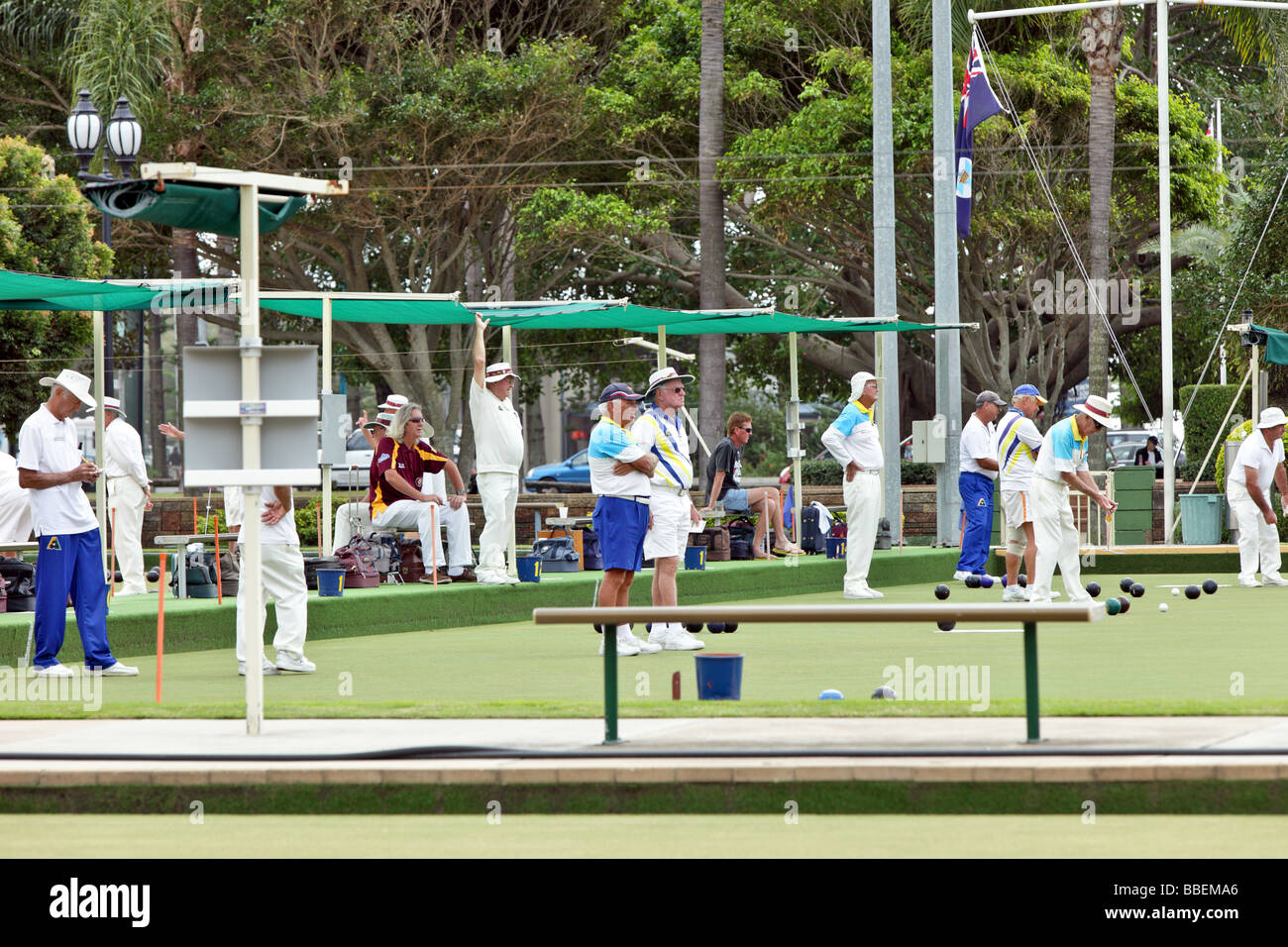 senior men playing lawn bowls in a competition - Stock Image
