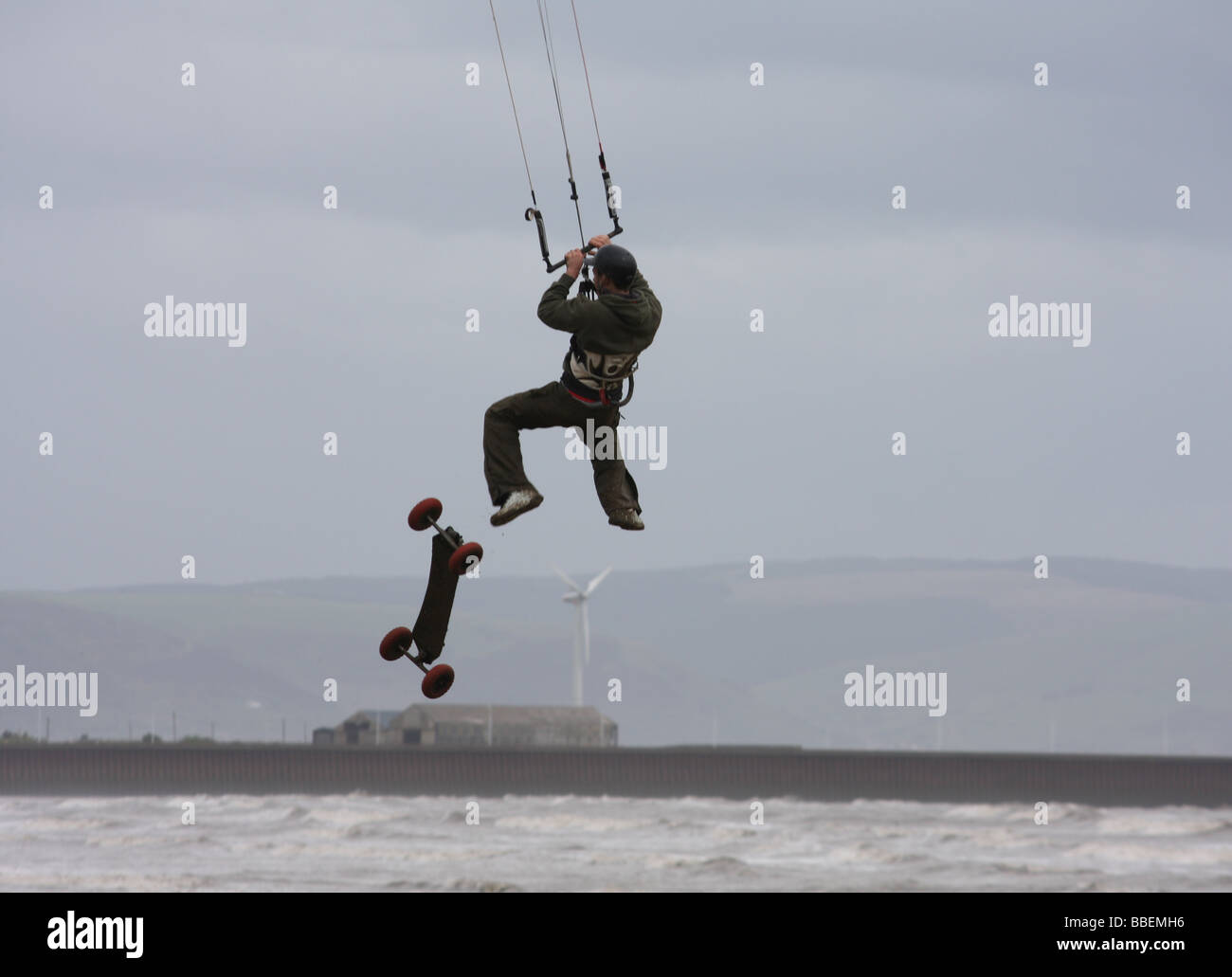 Kite landboarder loses his board. - Stock Image