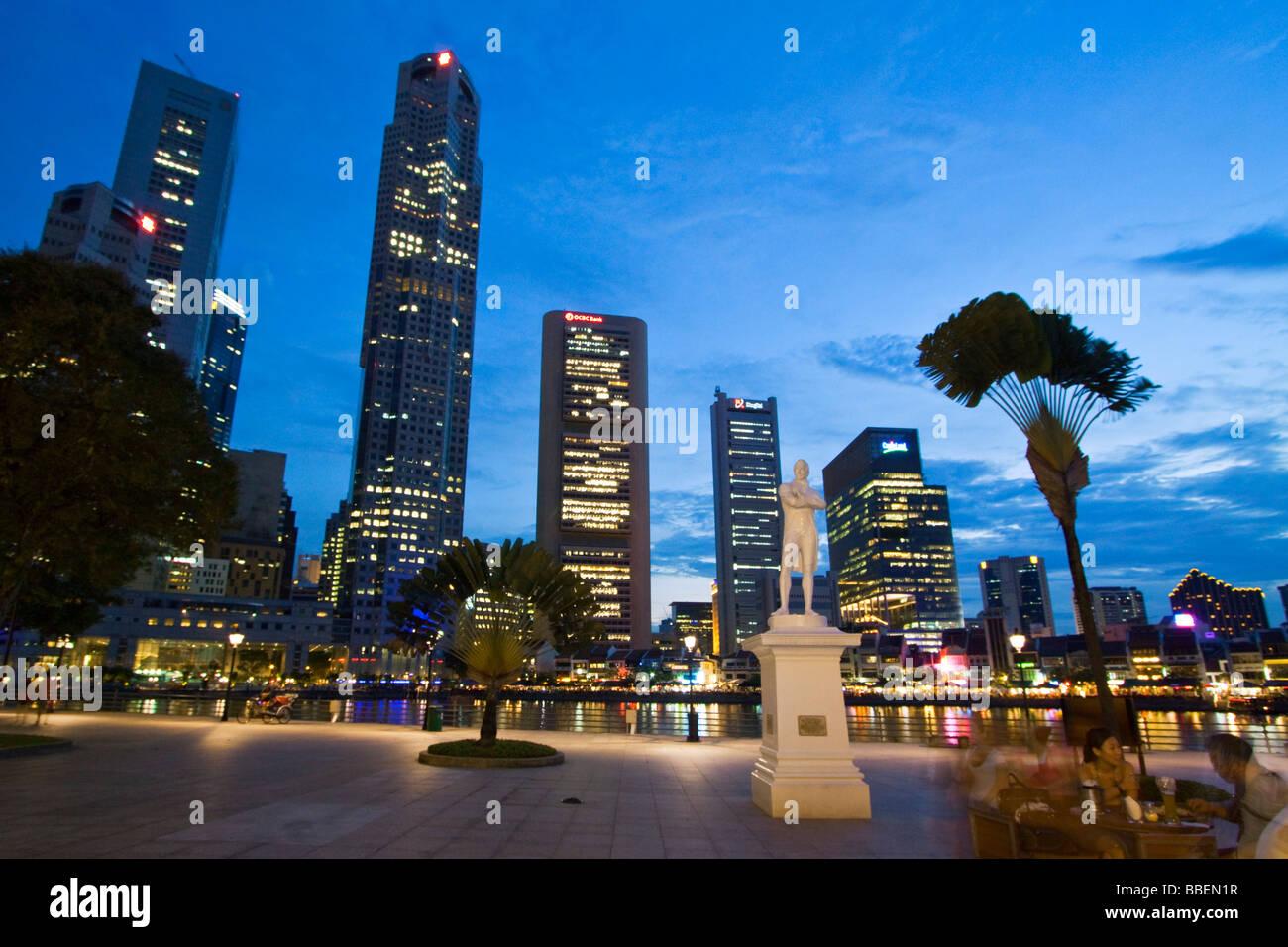 Skyline of Singapur Raffles Statue South East Asia twilight Singapore Stock Photo